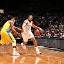 NEW YORK, NY - OCTOBER 7: Deron Williams #8 of the Brooklyn Nets dribbles the ball against the Maccabi Tel Aviv at the Barclays Center on October 7, 2014 in the Brooklyn borough of New York City. (Photo by Nathaniel S. Butler/NBAE via Getty Images)