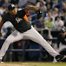 Miami Marlins relief pitcher Carlos Marmol delivers in the fourth inning of a spring exhibition baseball game against the New York Yankees in Tampa, Fla., Friday, March 28, 2014. Marmol was the losing pitcher in the Marlins' 3-0 loss to the Yankees The As