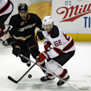 Anaheim Ducks left wing Dustin Penner (17) battles New Jersey Devils right wing Jaromir Jagr (68), of Czech Republic for the puck in the third period of an NHL hockey game Wednesday, Nov. 20, 2013 in Anaheim, Calif. The Devils won 4-3 in overtime The Asso
