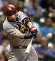 St. Louis Cardinals' Yadier Molina hits an RBI double during the fourth inning of a baseball game against the Milwaukee Brewers Monday, Aug. 19, 2013, in Milwaukee. (AP Photo/Morry Gash)