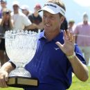 Former NHL hockey player Dan Quinn poses with the trophy after winning the American Century Championship celebrity golf tournament, Sunday, July 22, 2012, in Stateline, Nev. (AP Photo/The Tahoe Tribune, Joe Proudman)