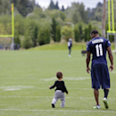 Seattle Seahawks wide receiver Percy Harvin, right, walks with his son Jaden, 1, on the field following the final day of NFL football training camp, Wednesday, Aug. 13, 2014, in Renton, Wash The Associated Press