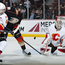 The Ducks' Patrick Maroon scores on Calgary goaltender Joni Ortio as Mark Giordano tries to defend during the first period of hockey at Honda Center Wednesday night Jan. 21, 2015 The Associated Press