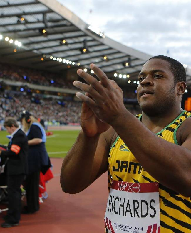 O'Dayne Richards of Jamaica celebrates after winning the gold medal in the men's shot put competition at Hampden Park Stadium during the Commonwealth Games 2014 in Glasgow, Scotland, Monday July 28, 2014