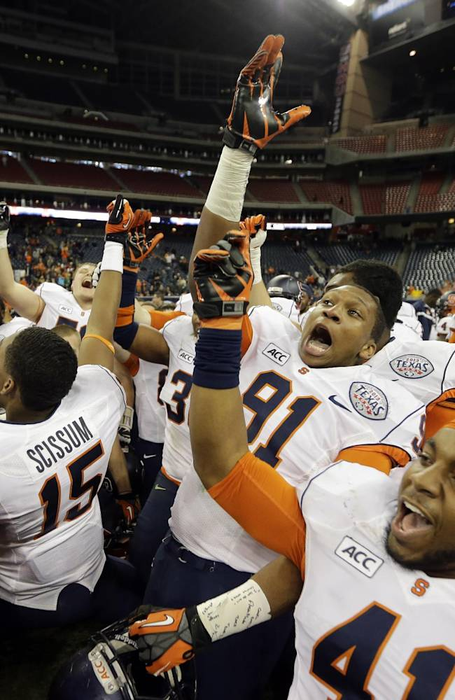 Syracuse players celebrate after winning the Texas Bowl NCAA college football game against Minnesota, Friday, Dec. 27, 2013, in Houston. Syracuse won 21-17