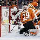 Arizona Coyotes' Sam Gagner (9), left, makes sure the puck hit by Connor Murphy , not pictured, goes in the net behind Philadelphia Flyers goalie Ray Emery (29) in the first period of an NHL hockey game, Tuesday, Jan. 27, 2015, in Philadelphia. (AP Photo/Tom Mihalek)