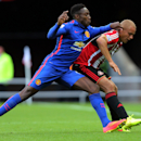 Manchester United's Danny Welbeck, left, vies for the ball with Sunderland's Wes Brown, right, during their English Premier League soccer match at the Stadium of Light, Sunderland, England, Sunday, Aug. 24, 2014