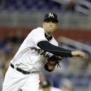 Miami Marlins starting pitcher Alex Sanabia throws to first in the first inning during a baseball game against the Philadelphia Phillies in Miami, Monday, May 20, 2013. (AP Photo/Lynne Sladky)