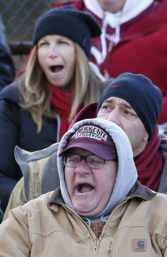 Lafayette fans let out yawns as their team gets routed by New Hampshire in an NCAA college football playoff game, Saturday, Nov. 30, 2013 in Durham, N.H