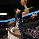 Minnesota Timberwolves' Kevin Martin, right, lays up a shot leaving New York Knicks' Raymond Felton looking away in the first quarter of an NBA basketball game, Wednesday, March 5, 2014, in Minneapolis The Associated Press