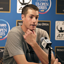 John Isner talks to the media during a news conference after withdrawing from the Winston-Salem Open tennis tournament in Winston-Salem, N.C., Thursday, Aug. 21, 2014. (AP Photo/Chuck Burton)