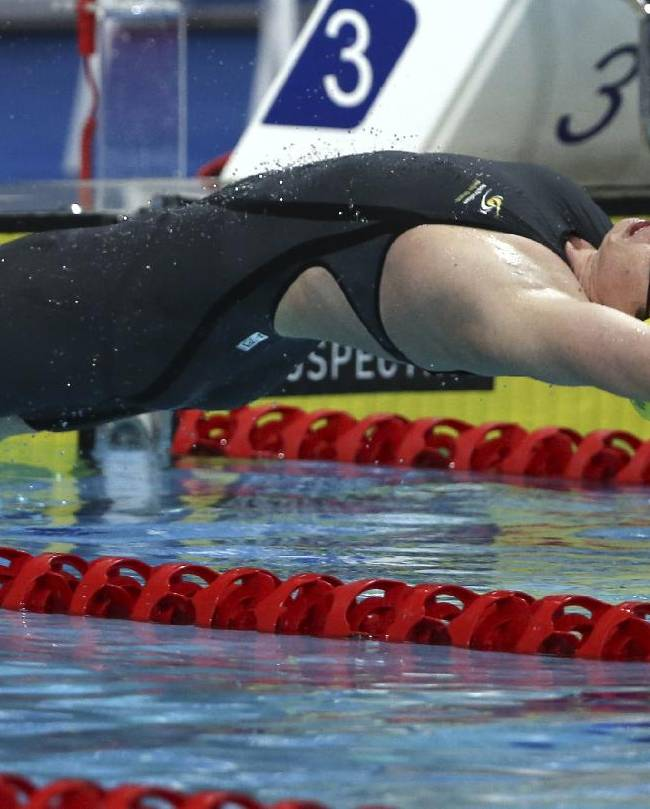 Emily Seebohm of Australia launches off the blocks during her women's 100m backstroke final at the Pan Pacific swimming championships in Gold Coast, Australia, Thursday, Aug. 21, 2014. Seebohm won the race ahead of team mate Belinda Hocking and Missy Franklin of the U.S
