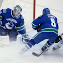 Vancouver Canucks goalie Eddie Lack, left, of Sweden, allows a goal to Dallas Stars' Colton Sceviour, not seen, as Canucks' Chris Tanev (8) and Stars' Shawn Horcoff (10) watch during the second period of an NHL hockey game Wednesday, Dec. 17, 2014, in Van
