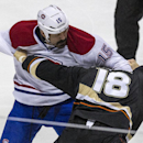 Montreal Canadiens right wing George Parros (15) fights with Anaheim Ducks right wing Tim Jackman (18) during the first period of an NHL hockey game, Wednesday, March 5, 2014, in Anaheim, Calif The Associated Press