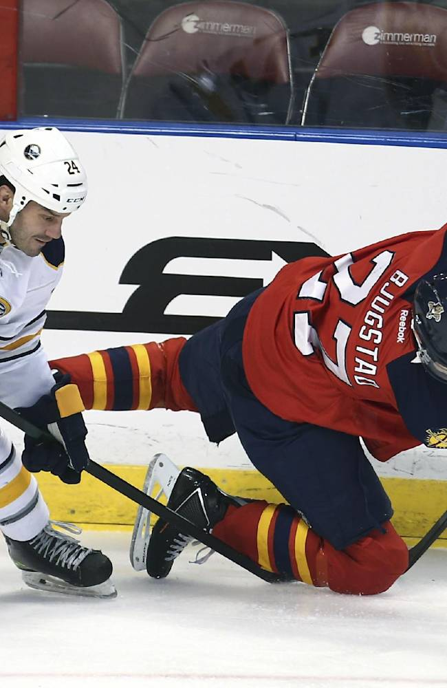 Buffalo Sabres' Zenon Konopka (24) and Florida Panthers' Nick Bjugstad (27) battle for the puck during the first period of an NHL hockey game in Sunrise, Fla., Friday, March 7, 2014