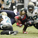 Jacksonville Jaguars free safety Josh Evans (26) and defensive end Tyson Alualu (93) stops Houston Texans running back Ben Tate (44) during the first quarter an NFL football game Sunday, Nov. 24, 2013, in Houston The Associated Press