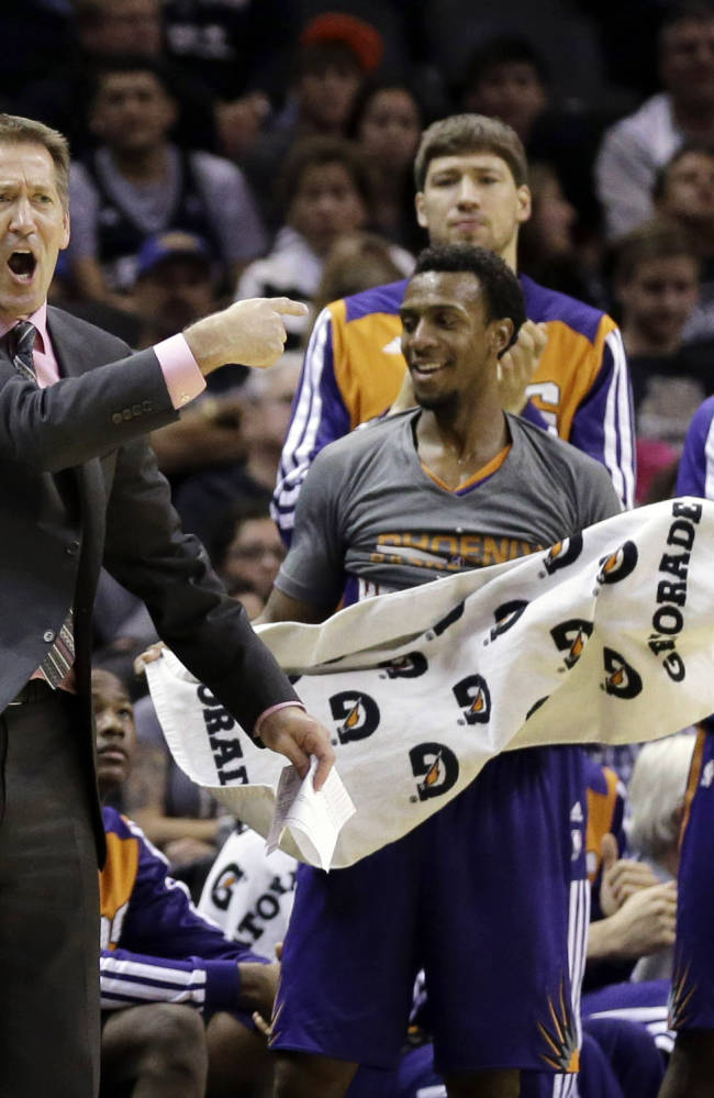 Phoenix Suns coach Jeff Hornacek, left, and players celebrate a basket against the San Antonio Spurs during the second half of an NBA basketball game Wednesday, Nov. 6, 2013, in San Antonio. San Antonio won 99-96