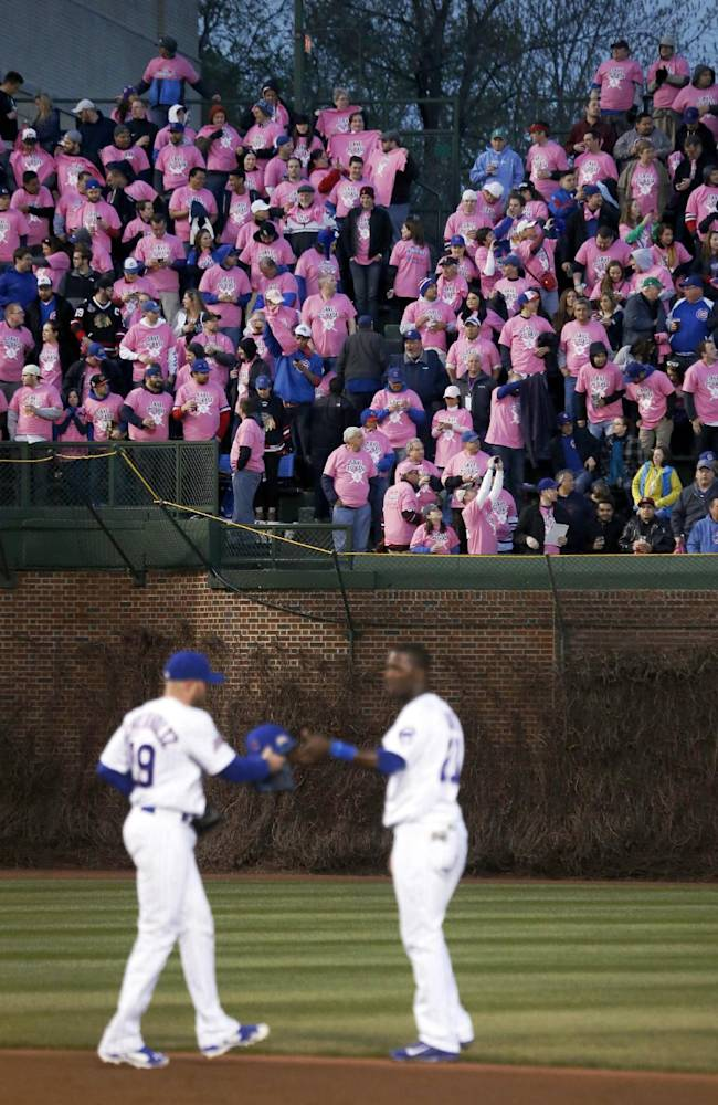 Cancer survivors, their family and friends wear pink during the third inning of an interleague baseball game between the Chicago Cubs and the Chicago White Sox, Tuesday, May 6, 2014, in Chicago