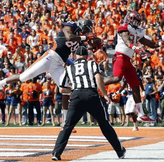 In this Sept. 28, 2013 file photo, Illinois tight end Evan Wilson (89) catches a touchdown pass in front of Miami (Ohio) defensive back Brison Burris (35) during an NCAA college football game in Champaign, Ill. The Illini have had strong tight ends, some talented enough to go on to the NFL. But they always seemed to be blockers and pass-route decoys first, receivers second. That's changing this season. Through four games Illinois' tight ends have about as many catches as they had all last season
