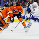 Toronto Maple Leafs' Trevor Smith, right, makes slap shot as Philadelphia Flyers' Mark Streit, left, looks to block it in the first period of an NHL hockey game, Saturday, Jan. 31, 2015, in Philadelphia. The Flyers won 1-0 The Associated Press