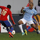 CSKA's Ahmed Musa, left, and Manchester City's Vincent Kompany, right, challenge for the ball during the Group E Champions League soccer match between CSKA Moscow and Manchester City at Arena Khimki stadium in Moscow, Russia, Tuesday, Oct. 21, 2014