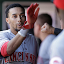 Cincinnati Reds' Billy Hamilton is congratulated by teammates in the dugout after scoring on a single by Brandon Phillips during the ninth inning of a baseball game on Wednesday, April 9, 2014, in St. Louis. The Reds won 4-0 The Associated Press