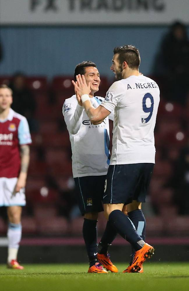 Manchester City's Alvaro Negredo, 2nd right, celebrates with teammates after scoring the opening goal during the second leg of the English League Cup semifinal soccer match between West Ham United and Manchester City at the Boleyn stadium in London, Tuesday, Jan 21  2014