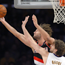 Portland Trail Blazers center Robin Lopez, left, puts up a shot as Los Angeles Lakers center Pau Gasol, of Spain, defends during the first half of an NBA basketball game Sunday, Dec. 1, 2013, in Los Angeles The Associated Press