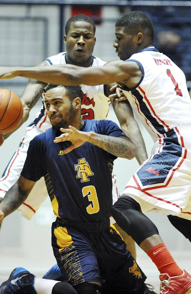 CORRECTS ID TO JEREMY UNDERWOOD, JEROME SIMMONS - North Carolina A&T's Jeremy Underwood (3) and Mississippi's Jarvis Summers (32) and  Martavious Newby (1) battle for the ball during an NCAA college basketball game at the C.M.