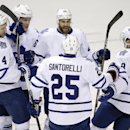Toronto Maple Leafs right wing Daniel Winnik (26) celebrates with teammates after scoring a goal against the Nashville Predators in the second period of an NHL hockey game Tuesday, Feb. 3, 2015, in Nashville, Tenn The Associated Press
