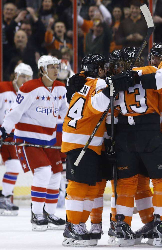 Philadelphia Flyers' players celebrate after a goal by Jakub Voracek, of the Czech Republic, during the first period of an NHL hockey game against the Washington Capitals, Wednesday, March 5, 2014, in Philadelphia