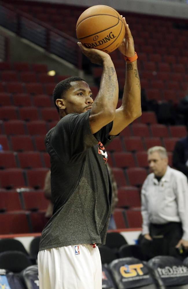 Chicago Bulls guard Derrick Rose warms up before an NBA preseason basketball game against the Detroit Pistons in Chicago on Wednesday, Oct. 16, 2013
