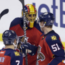 Florida Panthers goalie Roberto Luongo, center, is congratulated by teammates Brian Campbell (51) and Dmitry Kulikov (7) after a 3-2 win against the Columbus Blue Jackets of an NHL hockey game in Sunrise, Fla., Thursday, Jan. 29, 2015 The Associated Press