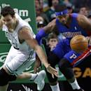 Detroit Pistons forward Josh Smith, right, steals the ball in front of Boston Celtics forward Kris Humphries in the first half of an NBA basketball game in Boston, Wednesday, Dec. 18, 2013. (AP Photo/Elise Amendola)