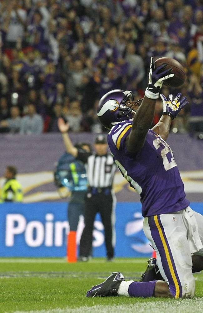Minnesota Vikings running back Adrian Peterson (28) celebrates after scoring a 3rd quarter touchdown during the NFL football game against Pittsburgh Steelers at Wembley Stadium, London, Sunday, Sept. 29, 2013