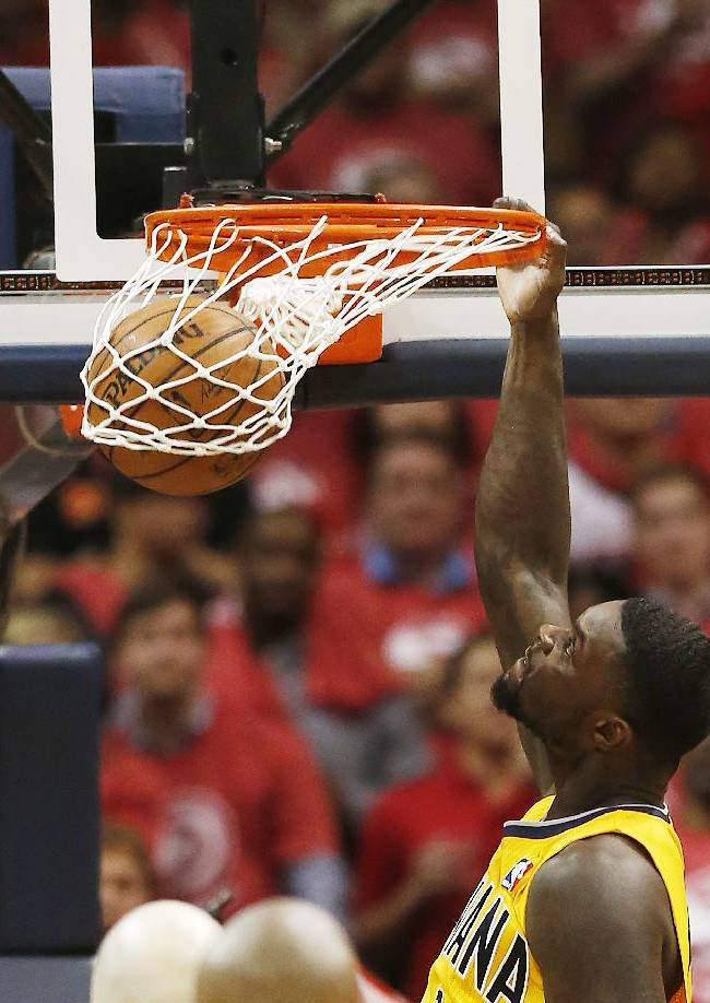 Indiana Pacers guard Lance Stephenson (1) scores against the Atlanta Hawks in the second half of Game 6 of a first-round NBA basketball playoff series in Atlanta, Thursday, May 1, 2014. Indiana won 95-88