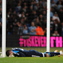 Sunderland's goalkeeper Vito Mannone reacts after a mistake that allowed Manchester City's Samir Nasri to score the equalizer during the English Premier League soccer match between Manchester City and Sunderland at The Etihad Stadium, Manchester, England,