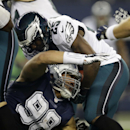 Dallas Cowboys' Tyrone Crawford (98) stops Philadelphia Eagles' LeSean McCoy (25) on a running play during the second half of an NFL football game, Thursday, Nov. 27, 2014, in Arlington, Texas The Associated Press