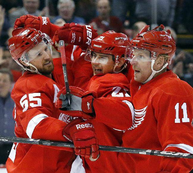Detroit Red Wings left wing Tomas Tatar (21), of the Czech Republic, celebrates his goal against the Philadelphia Flyers with Niklas Kronwall (55), of Sweden, and Daniel Alfredsson (11), also of Sweden,in the second period of an NHL hockey game in Detroit, Wednesday, Dec. 4, 2013