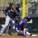 Colorado Rockies' Charlie Blackmon steals second as Seattle Mariners second baseman Robinson Cano applies the tag during the first inning of a spring exhibition baseball game, Saturday, March 29, 2014, in Scottsdale, Ariz The Associated Press