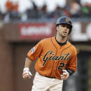 San Francisco Giants' Buster Posey circles the bases after hitting a two-run home run off Atlanta Braves starting pitcher Mike Foltynewicz during the first inning of a baseball game Friday, May 29, 2015, in San Francisco. (AP Photo/Eric Risberg)
