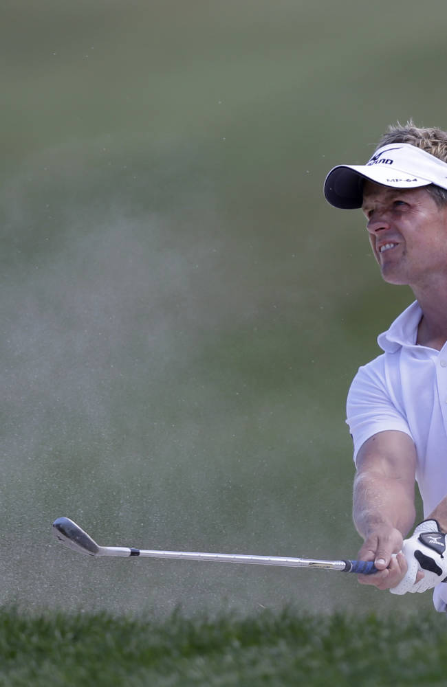 Golfer Luke Donald of England, watches his shot after hitting out of a bunker on the second hole during the third round of the Honda Classic golf tournament, Saturday, March 1, 2014 in Palm Beach Gardens, Fla