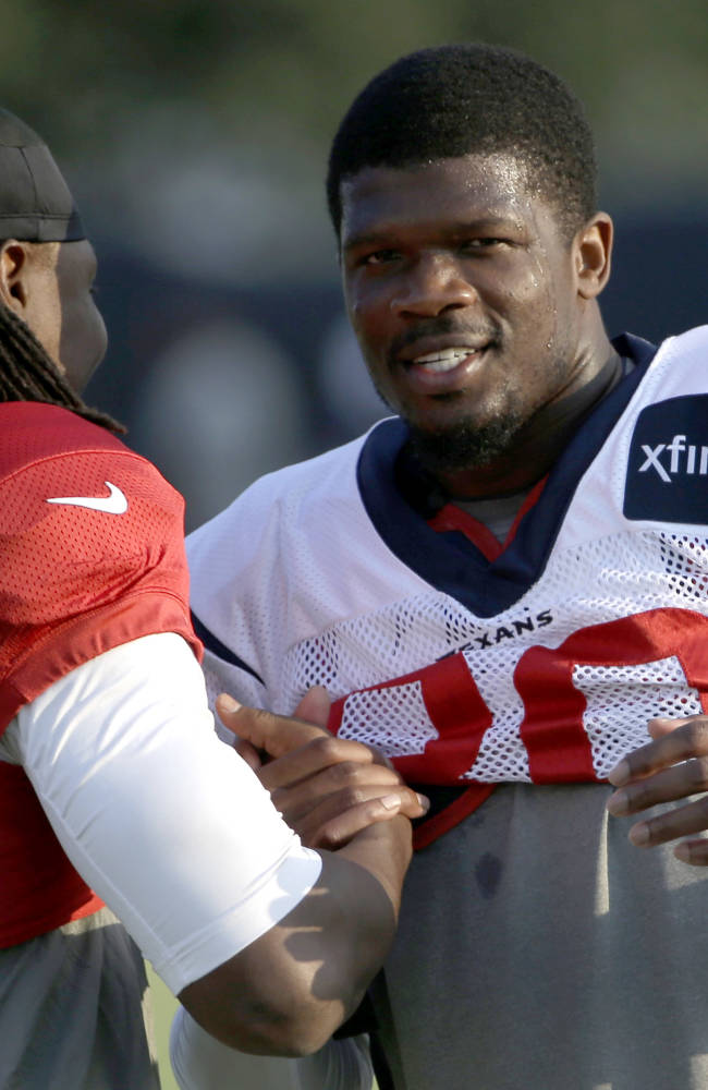 Houston Texans wide receiver Andre Johnson, right, talks with Atlanta Falcons wide receiver Roddy White (84) during an NFL football training camp practice Wednesday, Aug. 13, 2014, in Houston.The Falcons are practicing with the Texans this week before their preseason game Saturday