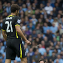 Manchester City's Frank Lampard sits on the pitch before being carried off injured during his team's English Premier soccer match against Tottenham Hotspur at the Etihad Stadium, Manchester, England, Saturday Oct. 18, 2014