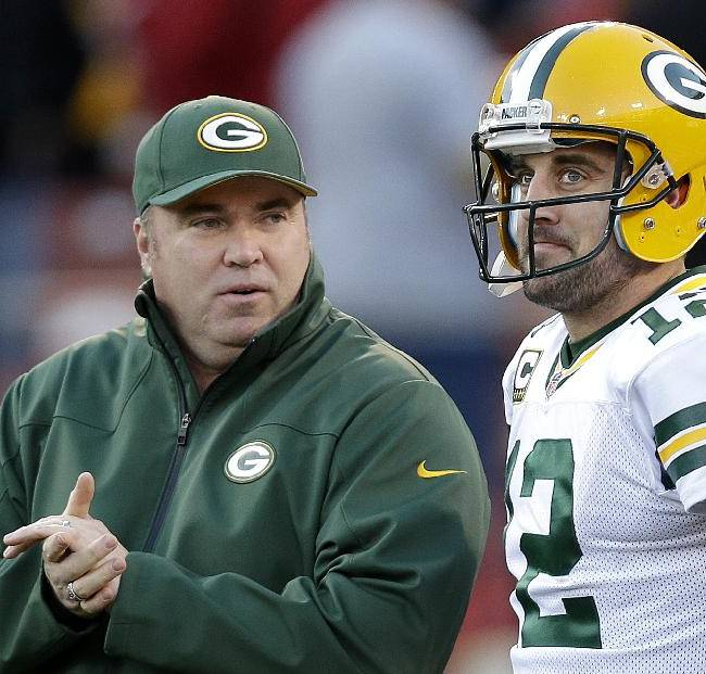 In this Jan. 12, 2013 file photo, Green Bay Packers head coach Mike McCarthy talks with quarterback Aaron Rodgers (12) before an NFC divisional playoff football game against the San Francisco 49ers in San Francisco