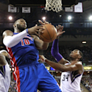 Detroit Pistons forward Greg Monroe, left, grabs a rebound against Sacramento Kings forward Jason Thompson during the fourth quarter of an NBA basketball game in Sacramento, Calif., Friday, Nov. 15, 2013. The Pistons won 97-90 The Associated Press