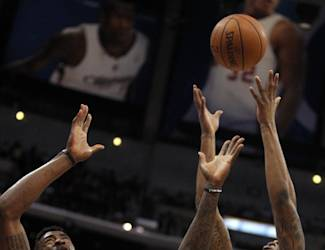 Los Angeles Clippers center DeAndre Jordan (6) battles for a rebound against Phoenix Suns forward Markieff Morris (11) during the first half of an NBA basketball game Monday, March 10, 2014, in Los Angeles. (AP Photo/Alex Gallardo)