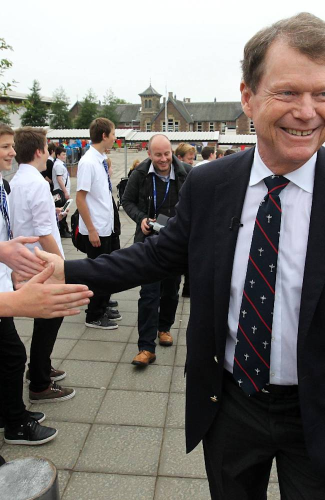 US Ryder Cup Captain Tom Watson, gestures with school children,  during a visit to Auchterarder Primary School, as part of the launch of the Ryder Cup, in Perthshire, Scotland,  Tuesday Sept. 24, 2013