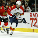 Florida Panthers center Jonathan Huberdeau (11) advances past Chicago Blackhawks left wing Brandon Bollig (52) during the first period of an NHL hockey game on Sunday, Dec. 8, 2013, in Chicago, Ill The Associated Press
