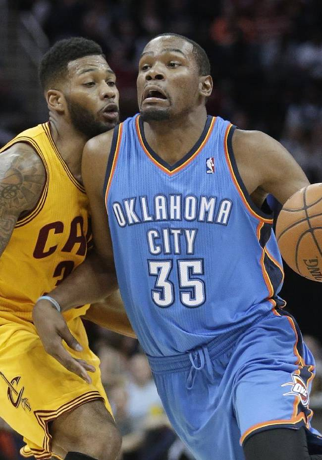 Oklahoma City Thunder's Kevin Durant (35) is fouled by Cleveland Cavaliers' Alonzo Gee (33) during the third quarter of an NBA basketball game Thursday, March 20, 2014, in Cleveland. Oklahoma City defeated Cleveland 102-95